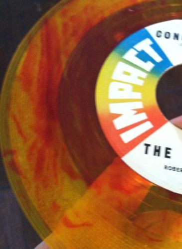 Revels-revillion-conga-twist-impact-7-yellow-red-swirl-colored-vinyl-record-45_5126993