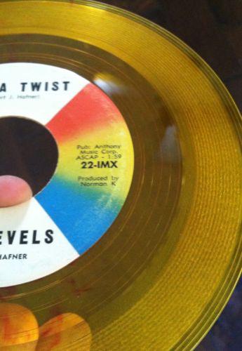 Revels-revillion-conga-twist-impact-7-yellow-red-swirl-colored-vinyl-record-45_5127001